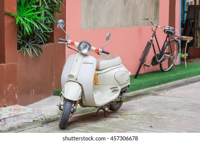 """CHANTABURI - JULY,24 : Scooter Vespa parked on old street in ancient sea port town. named :MUAENG CHAN"""" . THAILAND JULY,24 2016"""