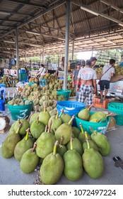 CHANTABURI, THAILAND - APRIL 19, 2018: Many farmers are selling  fruit at fresh fruit  market beside street.