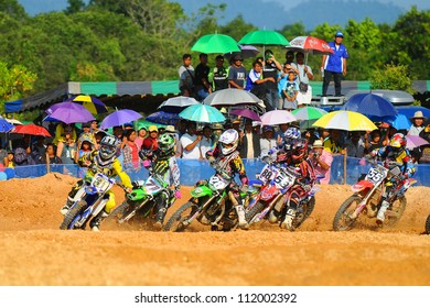 CHANTABURI, THAILAND - NOV 20: An unidentified riders participate in the final round of the 2011 Thailand motocross championship on November 20, 2011 in Chantaburi, Thailand.