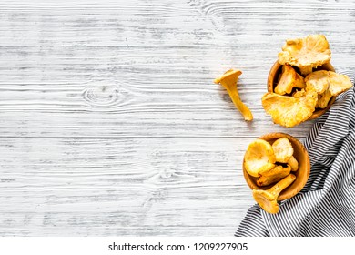 Chanterelle mushroom. Fresh raw chanterelles on grey wooden background top view copy space