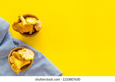 Chanterelle mushroom. Fresh raw chanterelles on yellow background top view copy space