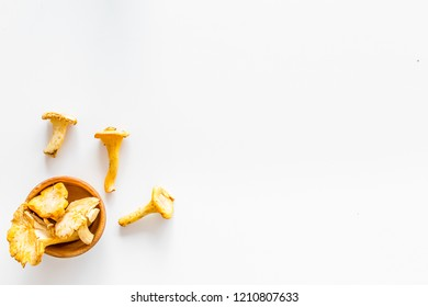 Chanterelle mushroom. Fresh raw chanterelles on white background top view space for text