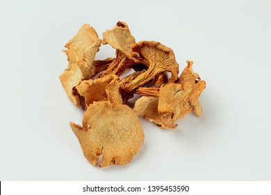 Chanterelle mushrooms dried on a white background. Bright natural color, high contrast, there is a place for text.