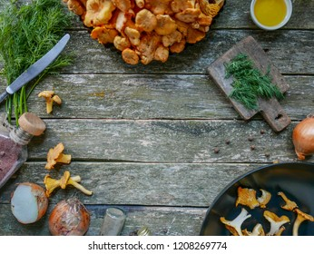 Chanterelle mushrooms, Raw wild chanterelles mushroom on wooden background. Organic Fresh chanterelle on a table. Border design