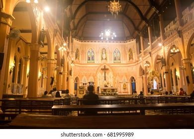 Chanthaburi ,Thailand , 9JULY2017 : Catholic church interior and people praying in the evening
