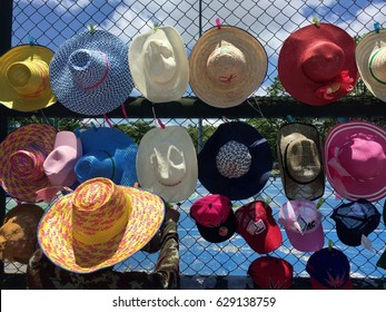 Chanthaburi (Thailand) - Apr 13, 2017. Local stall is set beside the street for selling hats helping people from strong sunlight in a sunny day with blue sky during Songkran Festival in Thailand.