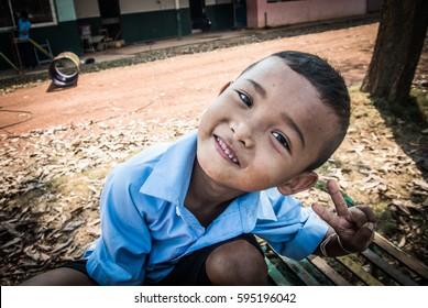 Chanthaburi, Thailand - FEB 22 2014 : Asian poor children in Thailand waiting for your help.