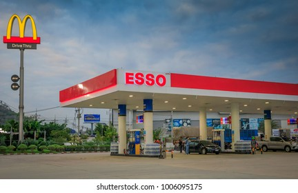 CHANTHABURI,THAILAND - JANUARY 15,2018 : The Esso fuel station with Mcdonalds sign in twilight time after sunset.