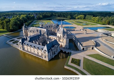Chantilly, France - 12 July 2017 : drone view of the Chantilly castle (Château de Chantilly ). historic chateau located in town of Chantilly, Oise, Picardie, France