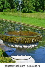 Chantilly, France - august 14 2016 :fountain in the park of Chantilly castle