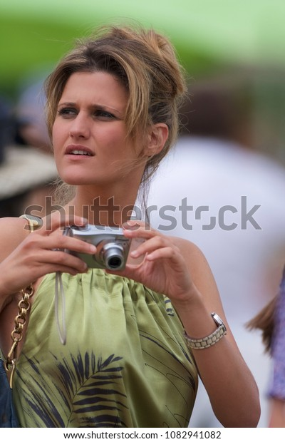 CHANTILLY, FRANCE - JUNE 13, 2010: elegant woman at the picnic party of the Prix de Diane, Chantilly.