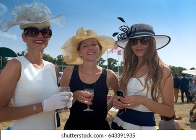 CHANTILLY, FRANCE - JUNE 14, 2015: gorgeous French women at the Prix de Diane which gathers every year thousands of elegant people for a brilliant picnic party on the hippodrome of Chantilly.