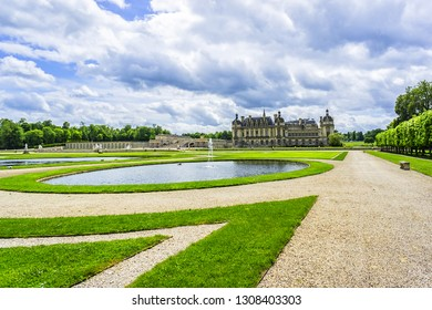CHANTILLY, FRANCE - MAY 9, 2014: Colorful park in famous Chateau de Chantilly. Chateau de Chantilly (1560) - historic chateau located in Chantilly town. Oise, Picardie, France.