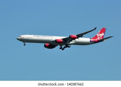 CHANTILLY, VA, USA - SEPTEMBER 24, 2012: Virgin Atlantic Airbus A340 landing at Dulles Airport. Virgin Atlantic is a British airline and part of Sir Richard Branson's Virgin Group.