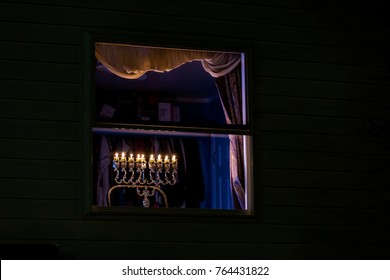 Chanukah Menorah in a widow