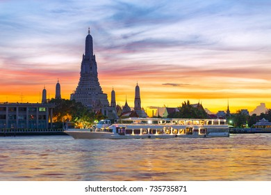 Chao Phraya River Cruise Boat with Temple of the Dawn, Wat Arun, at Sunset in Background, Horizontal