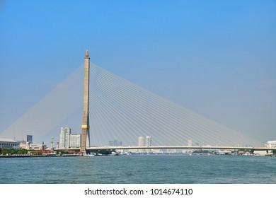 Chao Phraya river with famous Rama VIII Bridge in Bangkok, Thailand