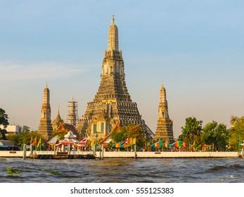 Chao Phraya River and Wat Arun Temple at sunrise. Bangkok, Thailand.