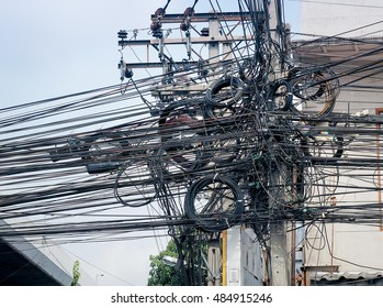 The chaos of cables and wires for commutation on every street in Bangkok, Thailand.