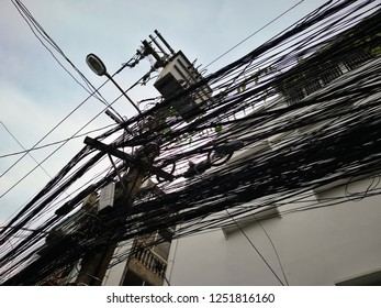 The chaos of cables and wires on every street in Bangkok, Thailand