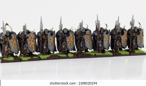 Chaos Knight Army. Toy knights for Fantasy gaming. Armed warriors. Hand painted army figurines with big shields and spears. Fantastic knights isolated on white.