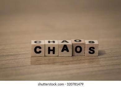 Chaos written in wooden cubes on a desk