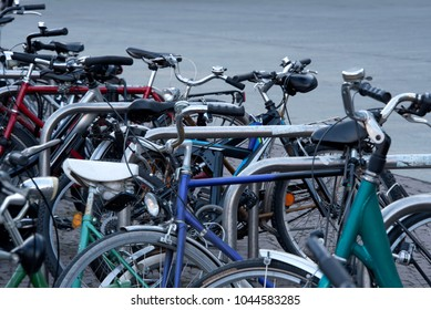 Chaotic bicycle/bike parking in a city - transport, public transport - stolen bikes, old bikes, bike theft - copy space
