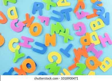 Chaotically scattered alphabet. Beautiful background of multi-colored letters.