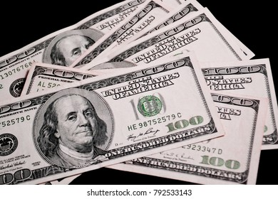 chaotically spread out money, bills of one hundred US dollars