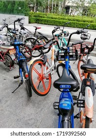 """CHAOYANG DISTRICT, BEIJING/CHINA- August 23, 2019: 用车一元 """"One Yuan per usage"""" rental for public bicycles."""