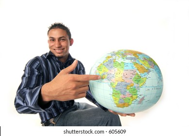 chap points out where his adventure awaits on the globe