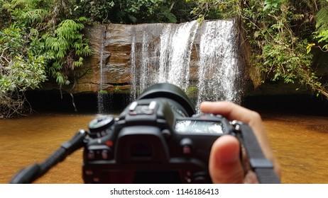 Chapada dos Guimarães, Brazil. June 2018. Cachoeira called Cachoeirinha, inside the National Park of Chapada dos Guimarães, from the point of view of a photographer and his camera.