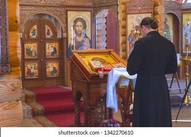 CHAPAEVSK, SAMARA REGION, RUSSIA - FEBRUARY 17, 2019: Church of the Kazan icon of the Mother of God in Chapaevsk. The priest is behind the lectern