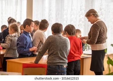 CHAPAEVSK, SAMARA REGION, RUSSIA - JANUARY 31, 2018: School kids of elementary school in the classroom with a female teacher