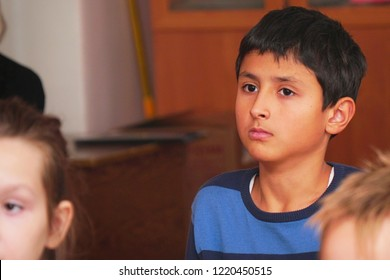 CHAPAEVSK, SAMARA REGION, RUSSIA - OCTOBER 24, 2018: Arabic schoolboy in the classroom listens to the teacher. Portrait of an arab schoolboy