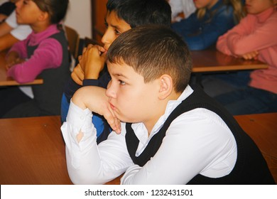 CHAPAEVSK, SAMARA REGION, RUSSIA - OCTOBER 24, 2018: Schoolboy in class listening to the teacher. Portrait of an unfamiliar schoolboy