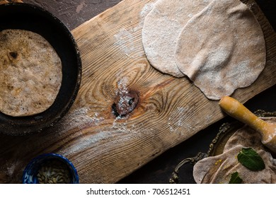 Chapati bread preparation on the wooden board horizontal