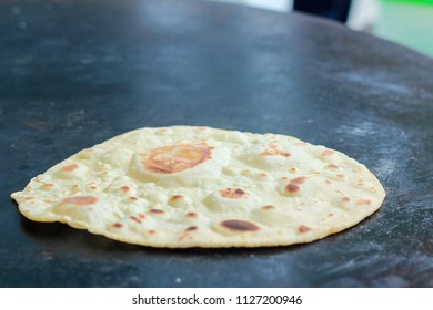 Chapati or paratha is Indian traditional flatbread made from wheat flour and ghee (traditional clarfied butter). It is the staple food for many asian country and usually served with curry and dhal.