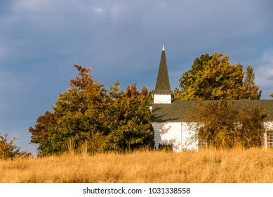Chapel in autumn, Discovery Park, Seattle, Washington. The park was created from US Army Fort Lawton (1900-2011). Photo was taken in 2008 after the park was created, but before complete fort closure.