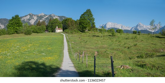 chapel in the bavarian alps in front of karwendel mountains. hiking area buckelwiesen, upper bavaria.