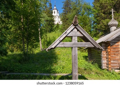 Chapel and cross at the burial place of the Holy Martyr Peter Zverev Archbishop of Voronezh in the Golgotha-Crucifix skete at Mount Calvary on Anzersky Island, Solovki Islands, Russia