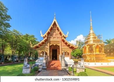 Chapel and golden pagoda at Wat Phra Singh Woramahawihan in Chiang Mai, North of Thailand