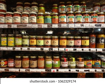 CHAPEL HILL, NC - JAN 2015: Salsa Jars Lined Up on Supermarket Shelves