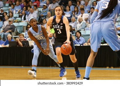 CHAPEL HILL, NC-FEB 28: Duke Blue Devils guard Angela Salvadores (3) dribbles as University of North Carolina Tar Heels guard Jamie Cherry (10) gives chase on February 28, 2016 at Carmichael Arena.