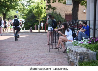 Chapel Hill, NC/United States- 08/26/2018: A female student checks her phone while taking a break as school is back in session at UNC Chapel Hill.