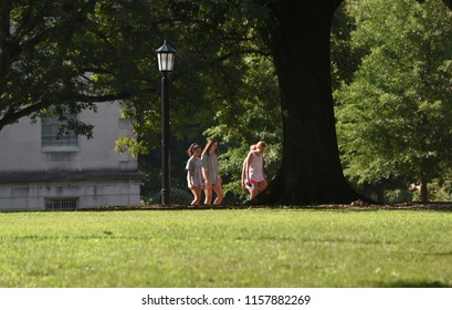 Chapel Hill,NC/United States- 08/16/2018: A group of female students walk across the quad on the campus of UNC-Chapel Hill.