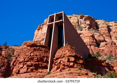 The Chapel of the Holy Cross is an iconic Catholic chapel built into the mesas of Sedona, Arizona.  It is built directly into a butte and offers a spectacular view of the valley below.