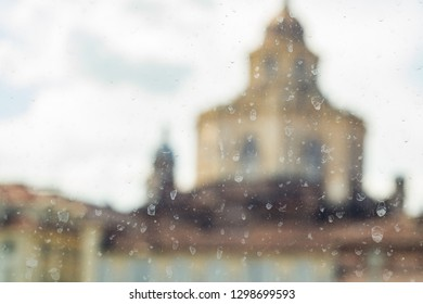 Chapel of the Holy Shroud of Turin blurred on dirty glass. defocused