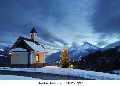 Chapel at Lockstein in Berchtesgaden with Christmas Tree in front of mount Watzmann.