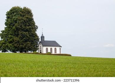 chapel next to a tree